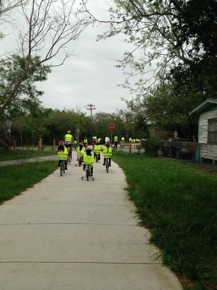 Children Wearing High Visibility Vests on Bike Path
